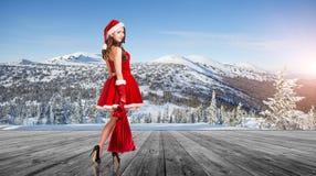 Женщина нося costume Santa Claus Стоковые Фото