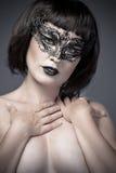 Женщина обнажённого, красивейший детеныш в черной маске Стоковое Изображение RF