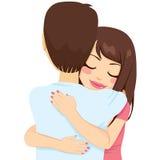 Женщина обнимая человека Стоковая Фотография RF