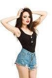 Женщина довольно молодой сексуальной моды чувственная представляя дальше Стоковое Фото