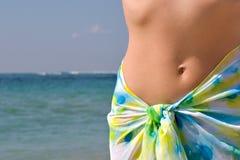 женщина океана живота стоковые изображения rf