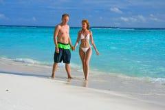 женщина океана людей Мальдивов пляжа Стоковые Изображения