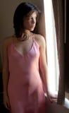 Женщина окном Стоковые Изображения RF