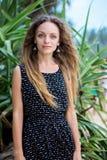 Женщина около тропических заводов Стоковые Фотографии RF