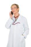 Женщина доктора на мобильном телефоне Стоковая Фотография