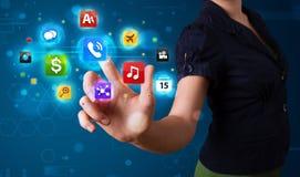 Женщина отжимая различное собрание высокотехнологичных кнопок Стоковые Изображения RF
