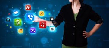 Женщина отжимая различное собрание высокотехнологичных кнопок Стоковое Изображение