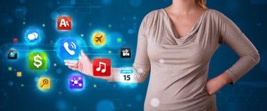 Женщина отжимая различное собрание высокотехнологичных кнопок Стоковое фото RF