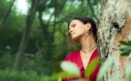 Женщина одетая в красном цвете стоковая фотография rf