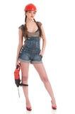 женщина перфоратора джинсыов удерживания сверла coverall Стоковое Фото