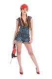 женщина перфоратора джинсыов удерживания сверла coverall Стоковая Фотография RF