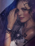 Женщина под черной вуалью Стоковое Фото