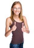Женщина показывает большому пальцу руки поднимающий вверх жест стоковые изображения