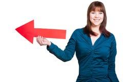 Женщина показывает правый путь Стоковые Изображения