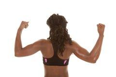 Женщина показывая мышцы назад стоковое фото rf
