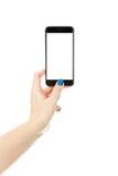 Женщина показывая умный телефон с изолированным экраном стоковая фотография