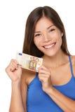 Женщина показывая деньги евро Стоковое фото RF