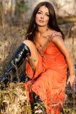 женщина померанца платья Стоковые Фотографии RF