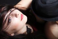 Женщина портрета в красном корсете стоковое изображение