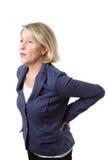 Женщина постаретая серединой с люмбаго Стоковые Изображения RF