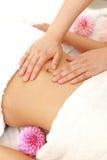 Женщина получая massage  живота Стоковая Фотография