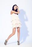 Женщина представляя нося платье Стоковые Изображения RF