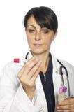 женщина предпосылки изолированная доктором белая Стоковое Изображение