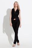 Женщина представляя в черном costume Стоковое Изображение