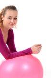 Женщина пригодности с усмехаться шарика радостный и счастливый, изолировано на w Стоковое Изображение RF