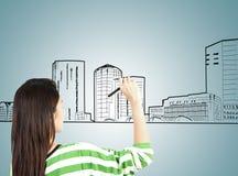 женщина притяжки городского пейзажа здания стоковое фото rf