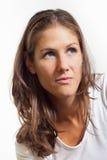 Женщина при голубые глазы смотря к углу стоковые изображения
