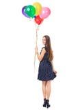 Женщина при красочные воздушные шары поворачивая вокруг Стоковые Изображения