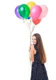 Женщина при красочные воздушные шары поворачивая вокруг Стоковое Фото