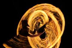 женщина против предпосылки огня стоковое фото rf