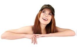 женщина пустой доски полагаясь сь Стоковое Изображение