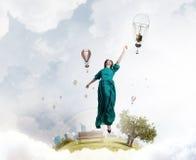 Женщина плавая в небо Стоковая Фотография RF