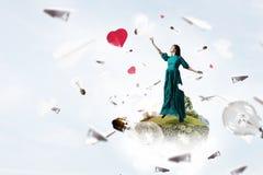 Женщина плавая в небо Стоковая Фотография