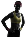 Женщина работая портрет силуэта разминки пригодности усмехаясь Стоковое Изображение RF