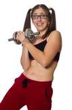Женщина работая при гантели изолированные на белизне Стоковые Изображения RF