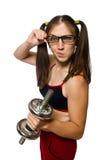 Женщина работая при гантели изолированные на белизне Стоковые Фото