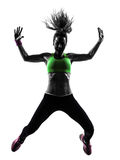 Женщина работая силуэт танцев zumba фитнеса скача Стоковое Изображение