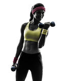 Женщина работая силуэт тренировки веса разминки фитнеса Стоковая Фотография
