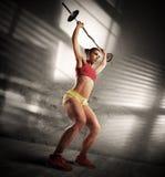 Женщина разминки атлетическая стоковое фото rf