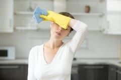 Женщина, расстроенная с работой о доме Стоковые Изображения