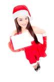 Женщина рождества держа пустой знак Стоковое Фото