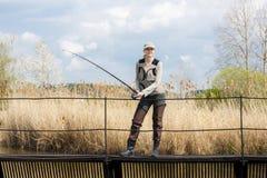 Женщина рыбной ловли Стоковое Изображение