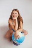Женщина рядом с глобусом Стоковые Фотографии RF