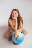 Женщина рядом с глобусом Стоковая Фотография RF