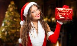 Женщина Санта Клауса давая вам подарок стоковое изображение rf