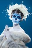 Женщина Санты Muerte на голубой предпосылке Стоковая Фотография RF